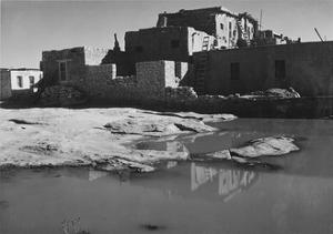 "Side View Of Adobe House With Water In Foreground"" Acoma Pueblo [NHL New Mexico]."" 1933-1942 by Ansel Adams"