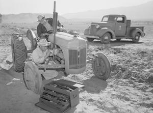 Tractor Repair: Driver Benji Iguchi, Mechanic Henry Hanawa, by Ansel Adams