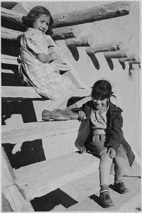 "Two Young Girls Sitting On Steps. At San Ildefonso Pueblo New Mexico 1942."" 1942 by Ansel Adams"