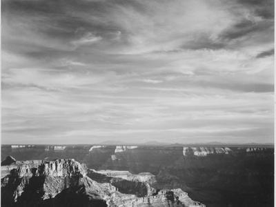 View Of Canyon In Fgnd Horizon Mts & Clouded Sky From North Rim 1941, Grand Canyon NP, Arizona 1941 by Ansel Adams