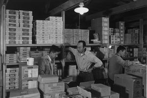 Warehouse manager M. Ogi with S. Sugimoto, manager of Co-op at Manzanar, 1943 by Ansel Adams