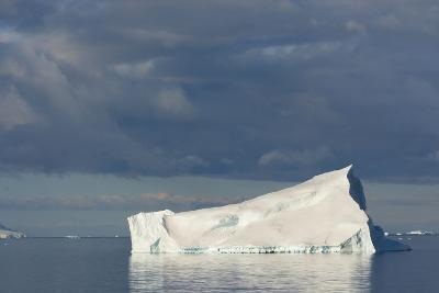 Antarctica. Gerlache Strait. Iceberg and Cloudy Skies-Inger Hogstrom-Photographic Print
