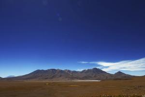 Bolivian desert, Bolivia. Arid landscape going toward lake and mountains. by Anthony Asael