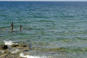 Malawi, Nkhata Bay, People Fishing in the Lake Malawi by Anthony Asael