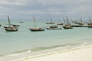 Tanzania, Zanzibar, Nungwi, Traditional Fisherman Boat on White Beach by Anthony Asael