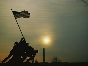 Silhouetted View of the Iwo Jima Memorial with the Capitol and Washington Monument Behind by Anthony Peritore