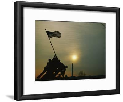 Silhouetted View of the Iwo Jima Memorial with the Capitol and Washington Monument Behind