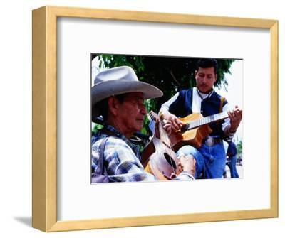 Men Strumming Guitars in Parque Libertad, San Salvador, El Salvador