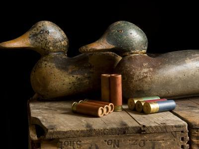 Antique Duck Decoys and Shotgun Shells Sit on an Old Wooden Crate-Joel Sartore-Photographic Print