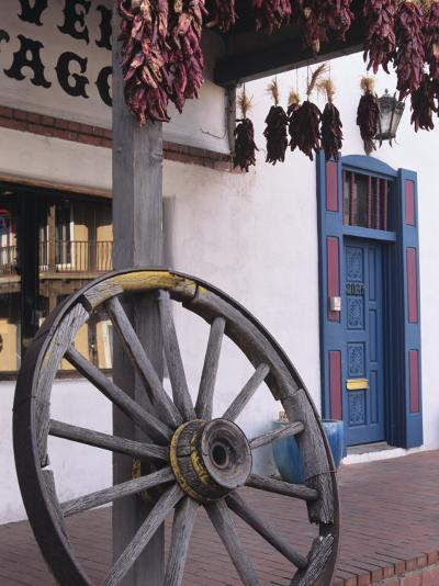 Antique wagon wheel, Old Town Albuquerque, New Mexico-Jerry Ginsberg-Photographic Print