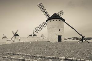 Antique windmills in a field, Campo De Criptana, Ciudad Real Province, Castilla La Mancha, Spain