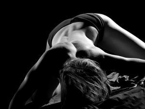 Woman's Back on Black Background by Antonino Barbagallo
