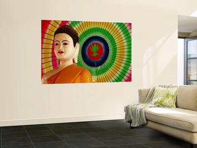 Buddha Statue and Colourful Parasol