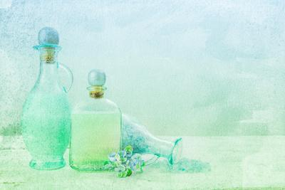 Bath Oil and Salt on a Textured Background