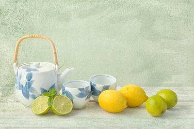 Citrus Fruit Still Life Against a Grunge Textured