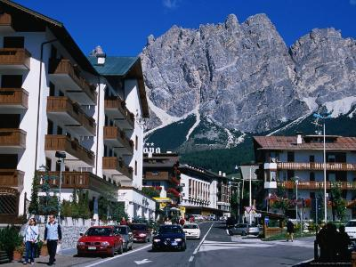 Apartment Buildings with Cliffs of Cristallo Group Behind, Cortina, Veneto, Italy-Grant Dixon-Photographic Print