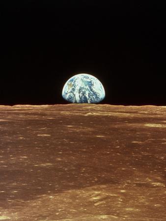 Apollo 11 View of Earth Rising Over Moon's Horizon