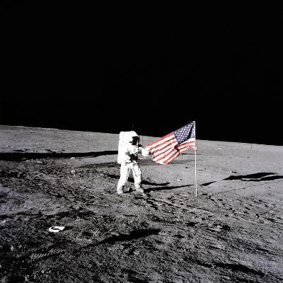 """Apollo 12 Astronaut Charles """"Pete"""" Conrad Stands Beside the United States Flag--Photo"""