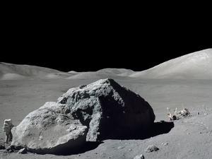 Apollo 17 Geologist-Astronaut Harrison Schmitt Standing Next to a Huge, Split Lunar Boulder