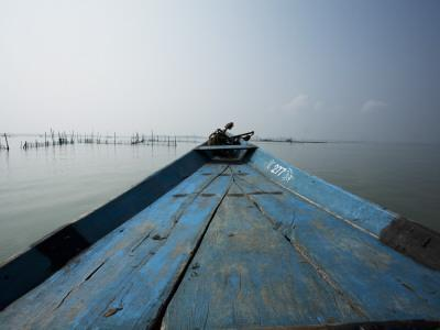 Boat on Lake with Fish Traps Ahead