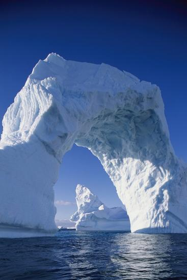 Arch Iceberg Near Lemaire Channel in Antarctica--Photographic Print