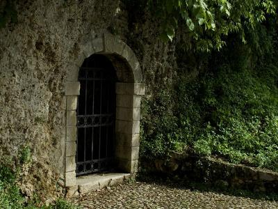Arched Doorway with Iron Grate, Asolo, Italy-Todd Gipstein-Photographic Print