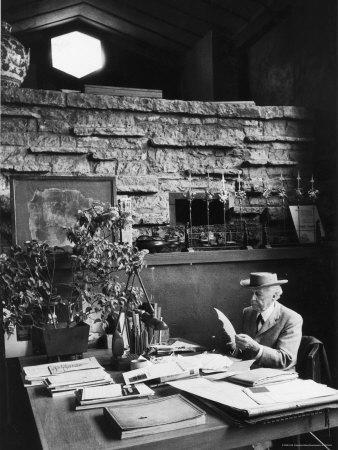https://imgc.artprintimages.com/img/print/architect-frank-lloyd-wright-working-at-desk-in-his-home-taliesin_u-l-p444m40.jpg?p=0