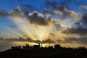 Sun Rays over Kotstrandarkirkja Church in Snaefellsnes Peninsula, Iceland by Arctic-Images