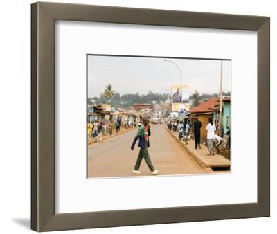 Man Crossing Road and People on Footpath, Kigali, Rwanda