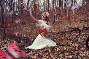 Young Adult Female with Butterflies in Woods by Ariel Marie Miller