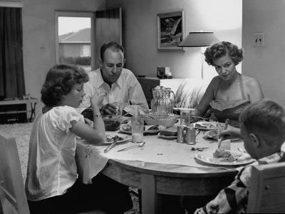 Arizona Family Seated at their Dining Room Table, Enjoying their Dinner-Nina Leen-Photographic Print