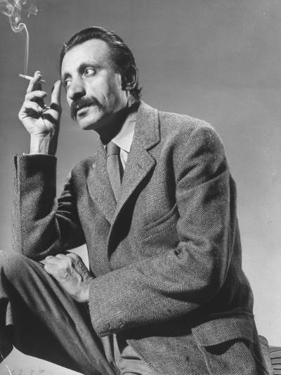 Armenian Artist Arshile Gorky Holding a Cigarette-Gjon Mili-Premium Photographic Print