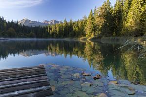 Sunrise in the Crestasee at Flims by Armin Mathis