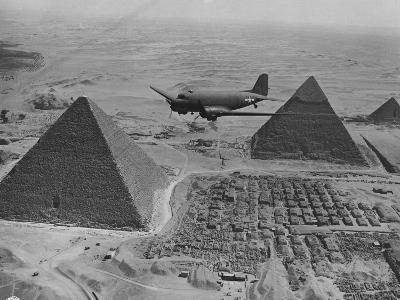 Army Supply Plane over the Pyramids--Photographic Print