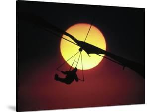 Hang Glider at Sunset by Arnie Rosner