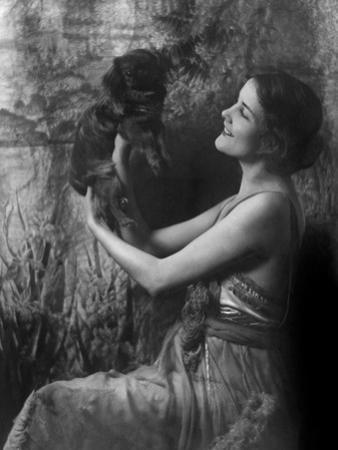 Vanity Fair - April 1921 - Woman Holding a Pekingese Dog Aloft