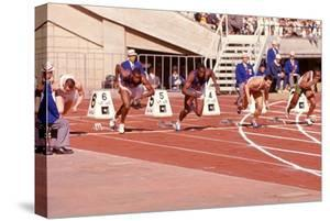 American Bob Hayes Taking Off from the Starting Block at Tokyo 1964 Summer Olympics, Japan by Art Rickerby