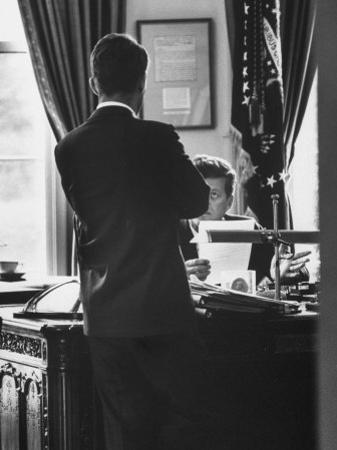 Attorney General Robert Kennedy, Conferring with Brother President John Kennedy at White House by Art Rickerby