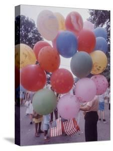 Balloons Sold by Man to People Watching Events, Kosygin's Second Visit to Glassboro, New Jersey by Art Rickerby