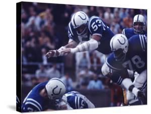 Baltimore Colts Football Player Dennis Gaubatz in Action by Art Rickerby