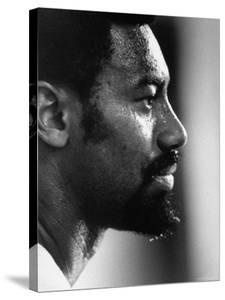 Close Up of Lakers Basketball Player, Wilt Chamberlain, Watching Lakers Play Boston Celtics by Art Rickerby