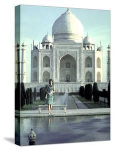 First Lady Jackie Kennedy Standing by Reflecting Pool in Front of Taj Mahal During Visit to India by Art Rickerby