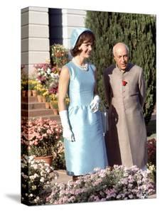 First Lady Jackie Kennedy with Indian Prime Minister Jawaharlal Nehru in Garden of His Residence by Art Rickerby