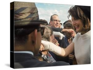 First Lady Jacqueline Kennedy with Husband Greeting Crowds at Airport During Campaign Tour of Texas by Art Rickerby