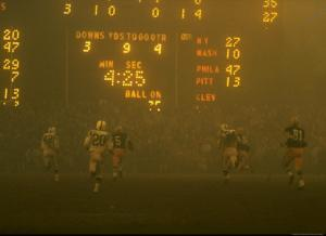 Green Bay Packers' Paul Hornung Eluding Baltimore Colt's Defense to Score 5th Touchdown of Game by Art Rickerby