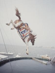 Horse with LBJ Banner Diving into the Water at Atlantic City by Art Rickerby