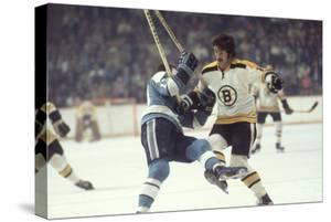 Nhl Boston Bruin Player Derek Sanderson Tripping Pittsburgh Penguin Player During Game by Art Rickerby