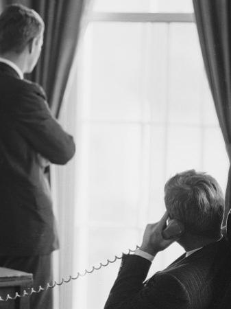 Pres. John F. Kennedy on Telephone While Brother, Attorney General Robert F. Kennedy Stands Nearby by Art Rickerby