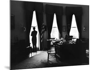 President John F. Kennedy and Attorney Gen. Robert F. Kennedy in the Oval Office at the White House by Art Rickerby