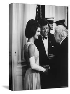 President John F. Kennedy and Wife Jackie with Poet Robert Frost at the White House by Art Rickerby